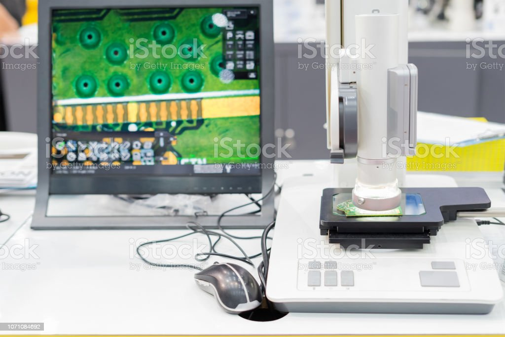 Inspection electronic circuit board by automate vision system show result on monitor stock photo
