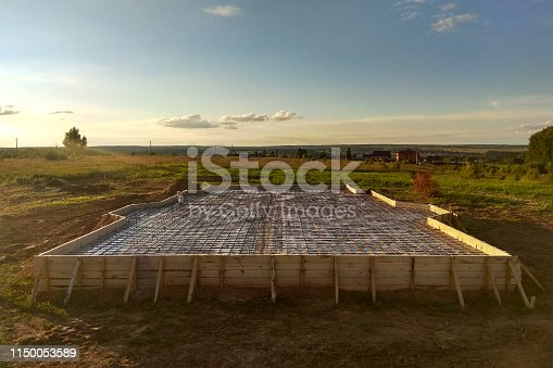 inspection well, trench and concrete slab of foundation with wooden formwork 2018