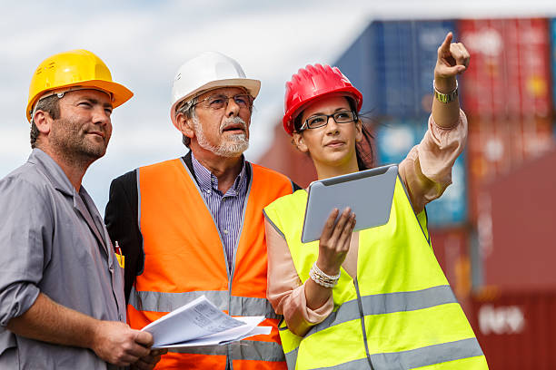 Inspections at commercial transport dock This is a photo of a team of people standing  project manager stock pictures, royalty-free photos & images