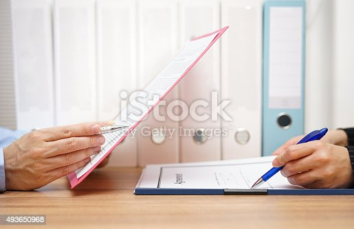 istock Inspector and auditor are inspecting legal and  financial documents 493650968