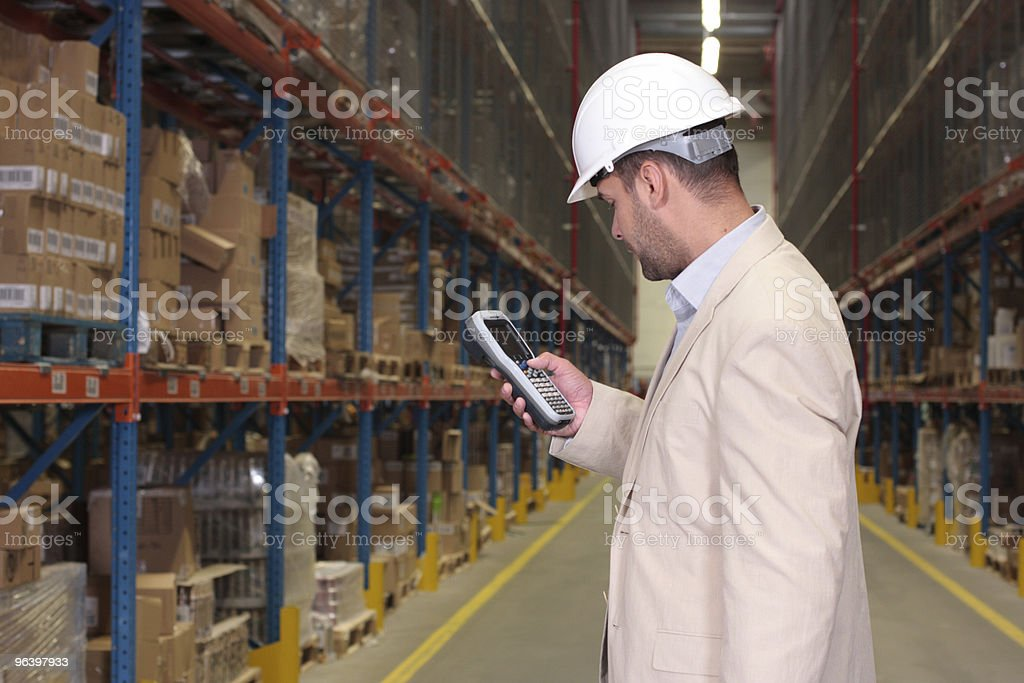 Inspector counting stocks royalty-free stock photo