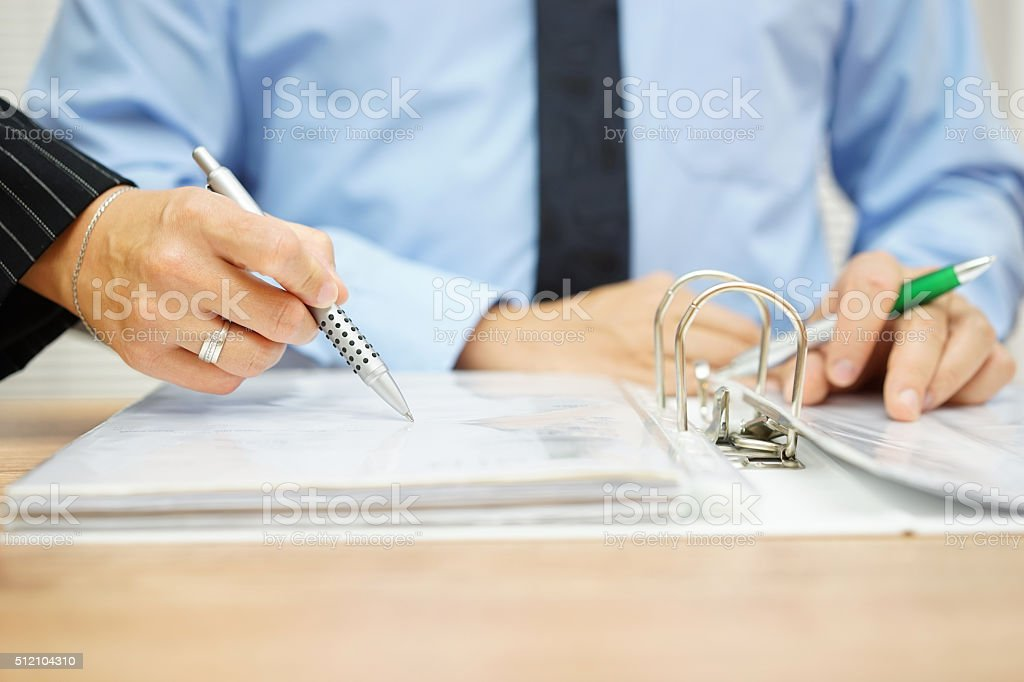 Inspector find fraud in company documentation stock photo