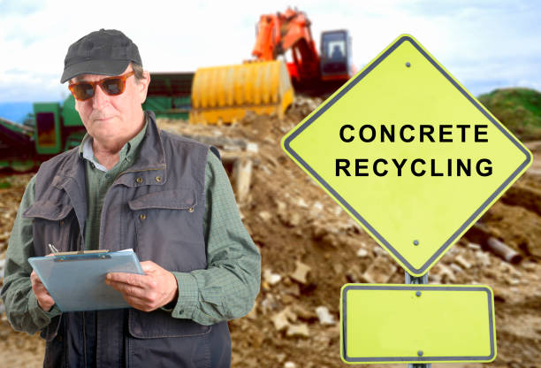 Inspector in Concrete recycling site stock photo