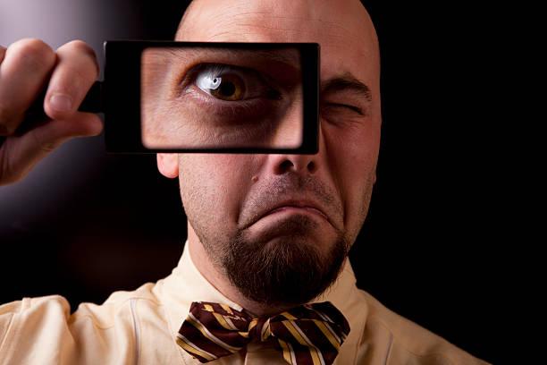 Kontrollinspektoren Blick durch die Lupe – Foto