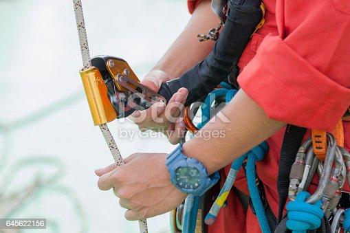 istock Inspector man wearing rope access equipment 645622156