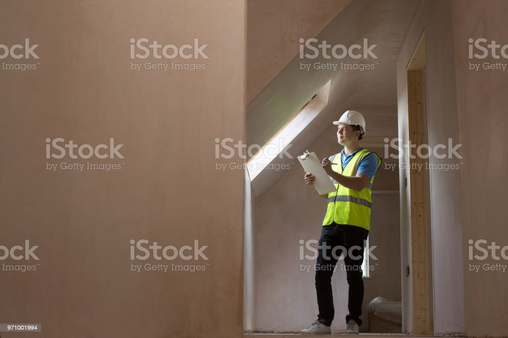 Inspector On Building Site With Clipboard stock photo