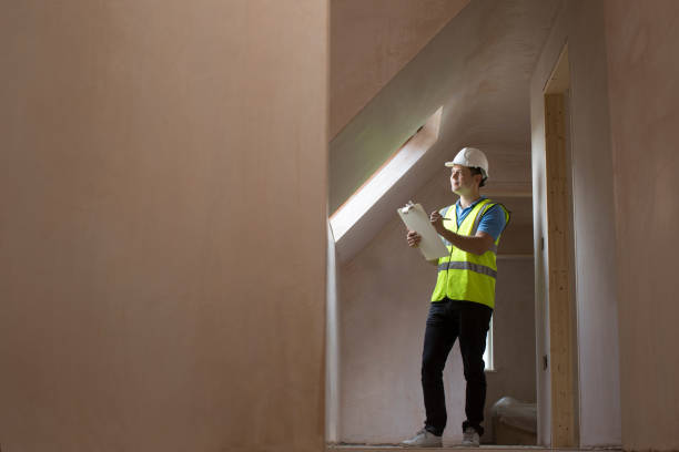 inspector on building site with clipboard - quality control stock photos and pictures