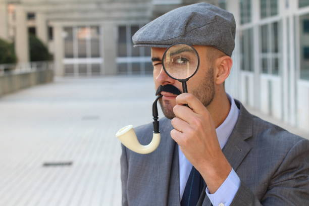 Inspector with magnifying glass close up Inspector with magnifying glass close up. deerstalker hat stock pictures, royalty-free photos & images