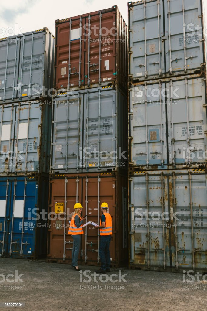 Inspectors checking cargo containers royalty-free stock photo