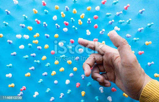 istock Inspiration creativity concepts with male hand push pin,thumbtack on blue background.Business ideas solution 1146810239