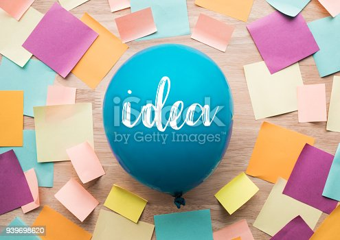 istock Inspiration ideas concepts with balloon and colorful notepaper on wood table. 939698620