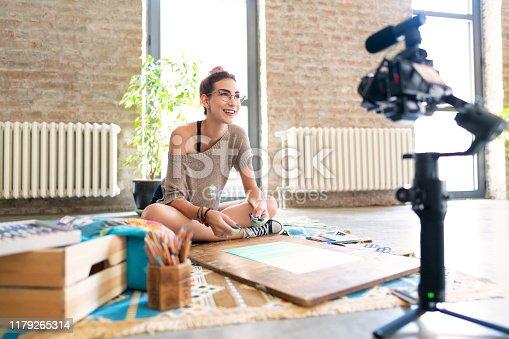 Beautiful female artist recording her video tutorial.