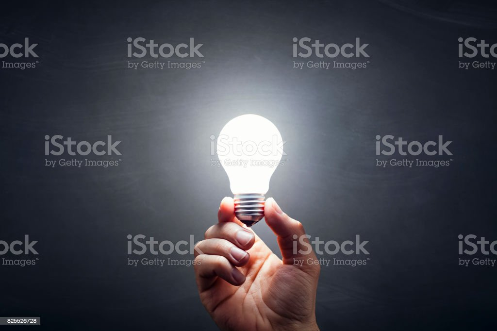Inspiration - Light Bulb Hand Idea Blackboard stock photo