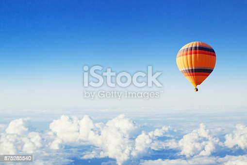 istock inspiration or travel background, hot air balloon over the clouds 875285540