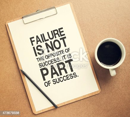 istock Inspirational motivating quote on success on clipboard 473679338