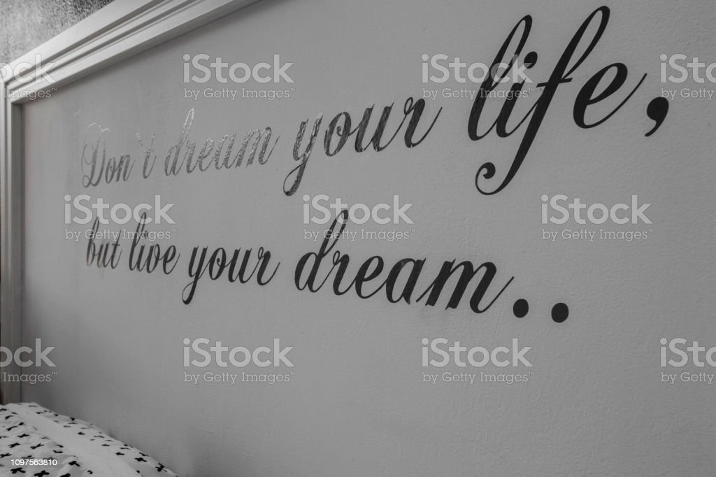Inspirational motivating quotes on wall, text don\'t dream your life...