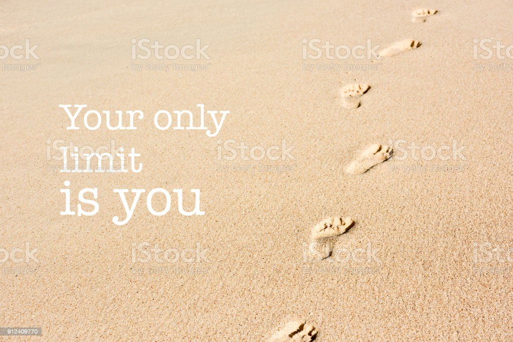 Inspirational Motivation Quote Footprints On Beach Sand Stock Photo