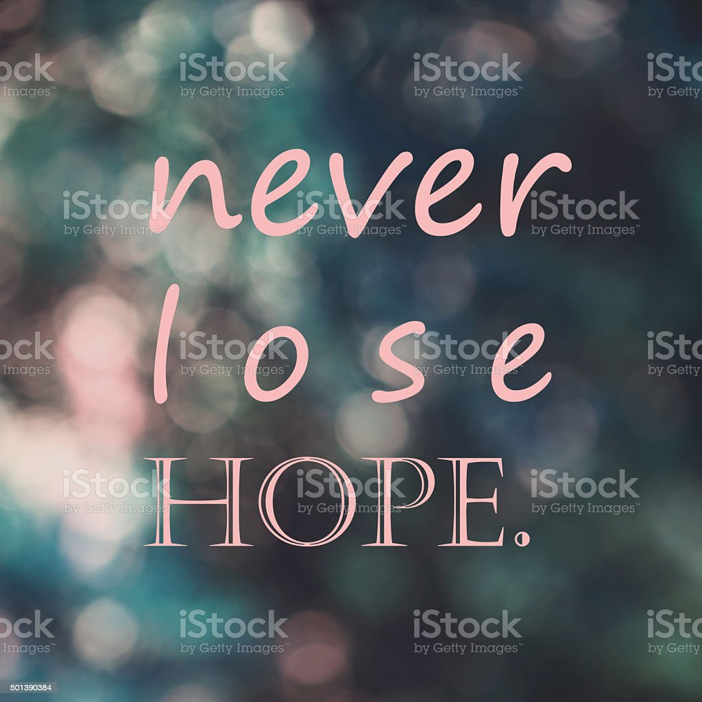 Inspirational motivational life quote ,'never lose hope' on blur stock photo