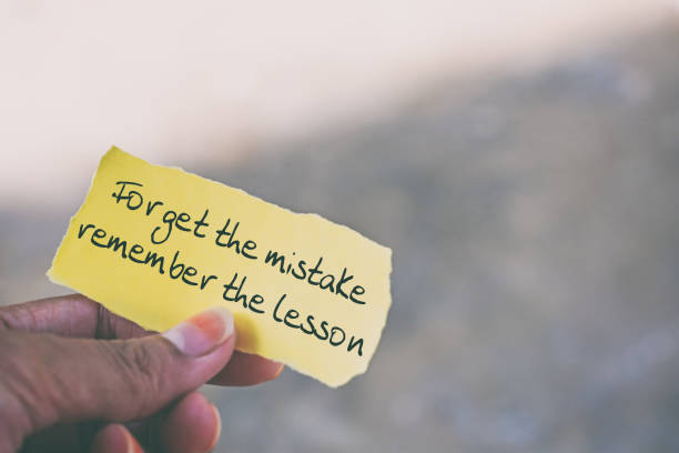 Inspirational quote - Forget the mistake, remember the lesson stock photo