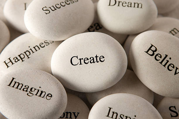 inspirational stones - create - single word stock photos and pictures