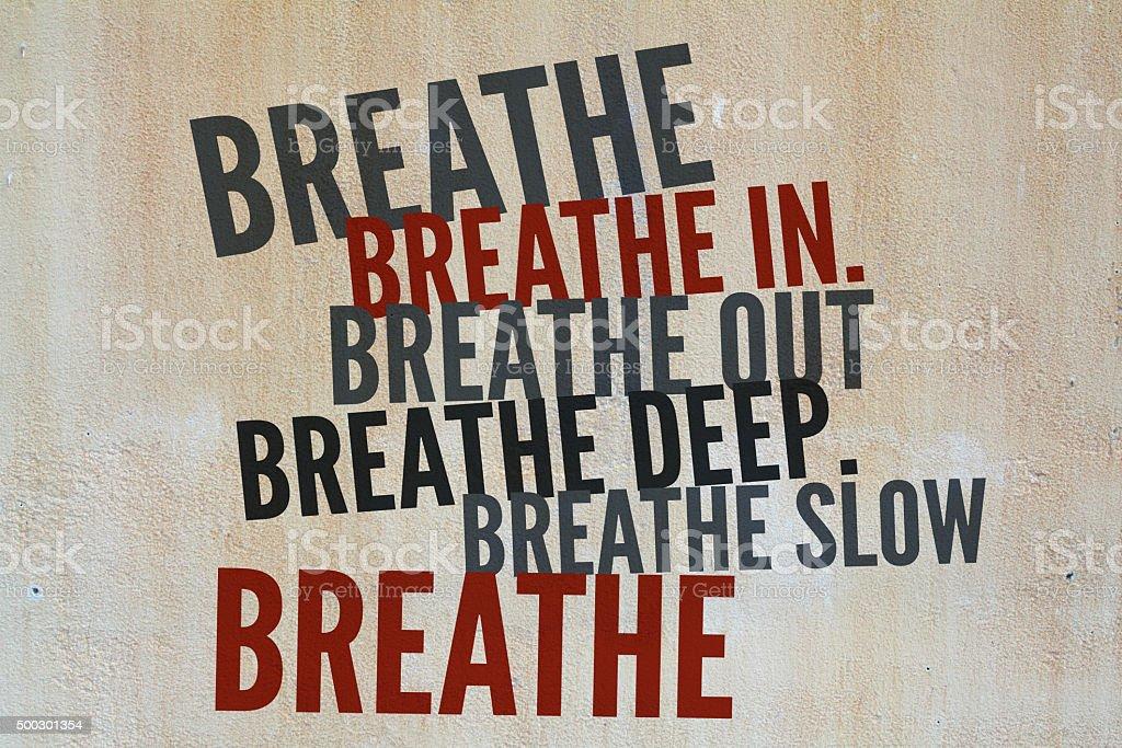 BREATHE Inspirational text on stone surface background stock photo