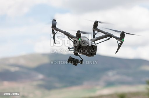 Ankara, Turkey - May 16, 2017: A quadrocopter Inspire Chinese technology company DJ Innovations (DJI). DJI was founded in 2006, it produces unmanned, remote controlled aerial vehicles for many fields of application, e.g. aerial photography and videography. Mounted camera and gimbal on the bottom of the device.