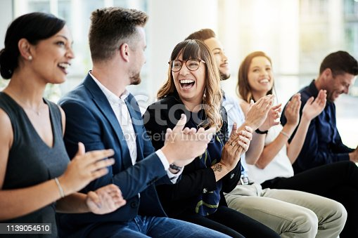 Shot of a group of businesspeople applauding during a seminar