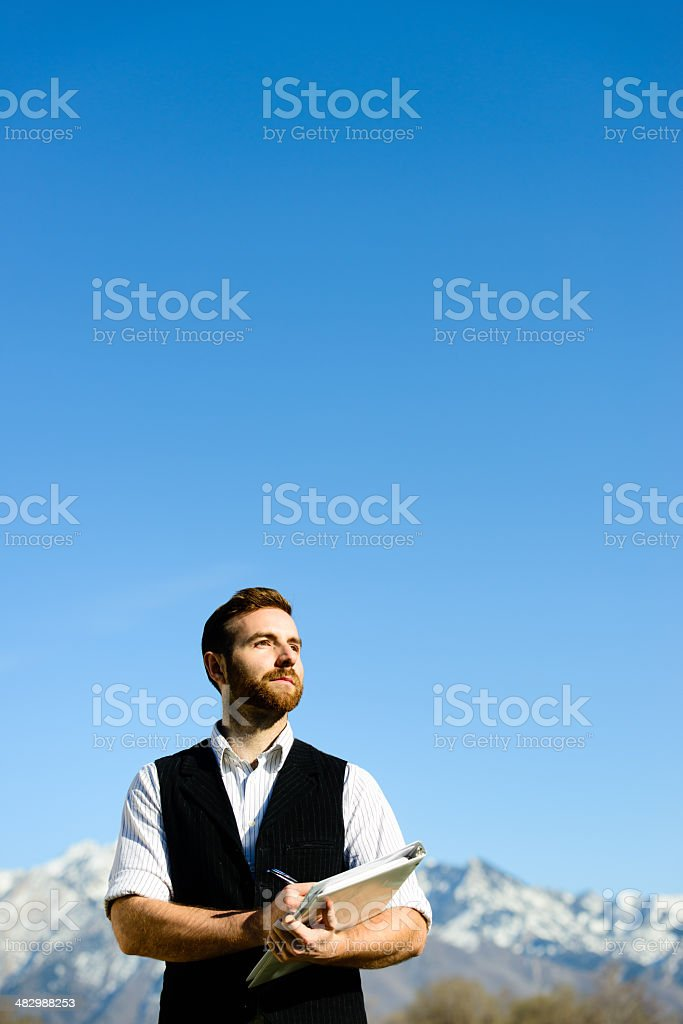 Inspired Businessman - Vertical royalty-free stock photo