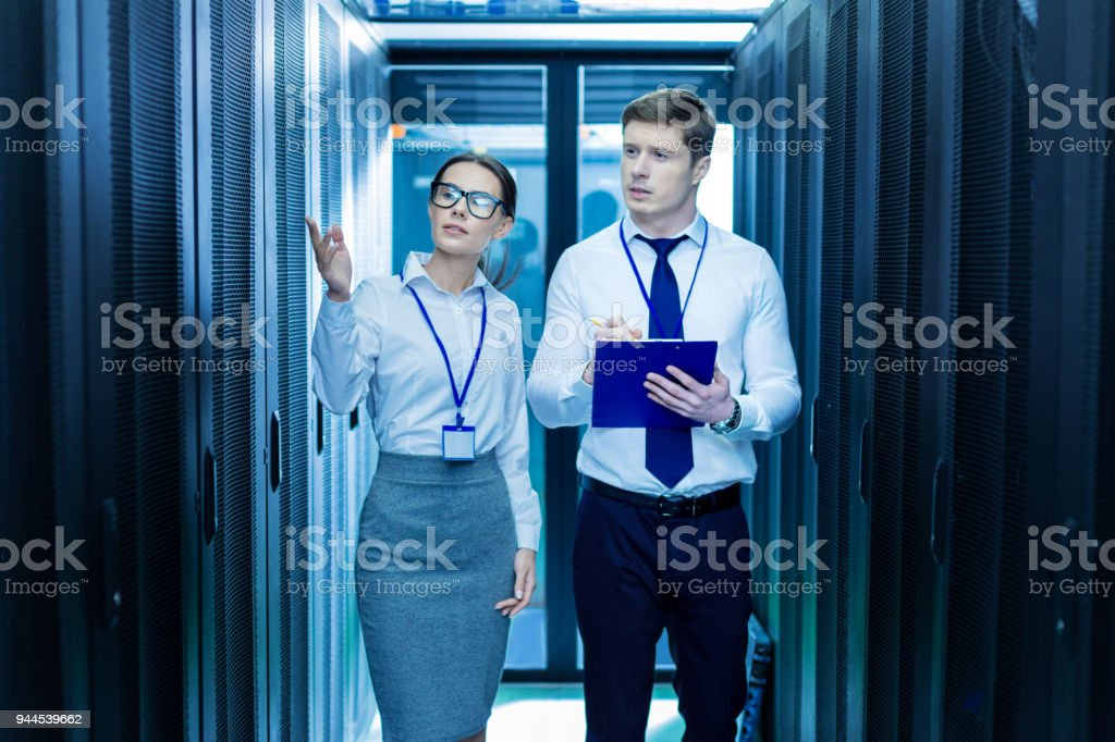 Inspired co-workers talking about work stock photo