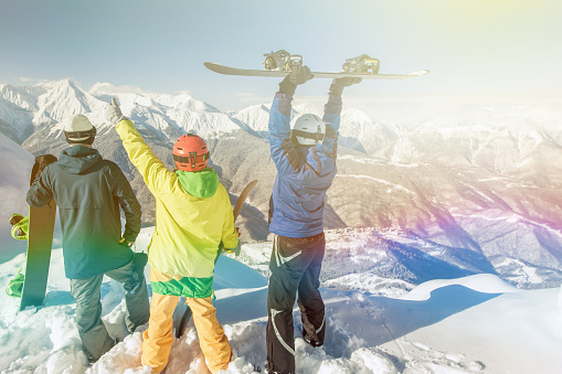 istock Inspired group of snowboarders at summit 508952674