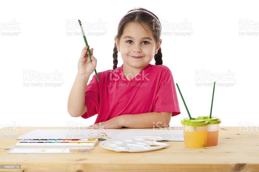 Inspired little girl with paintbrush royalty-free stock photo