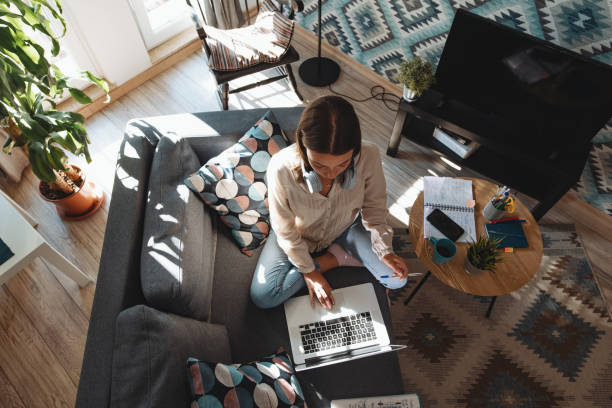Inspired millennial woman working freelance work from home during quarantine