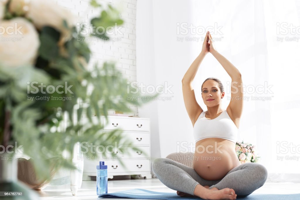 Inspired pregnant woman preparing for birth royalty-free stock photo