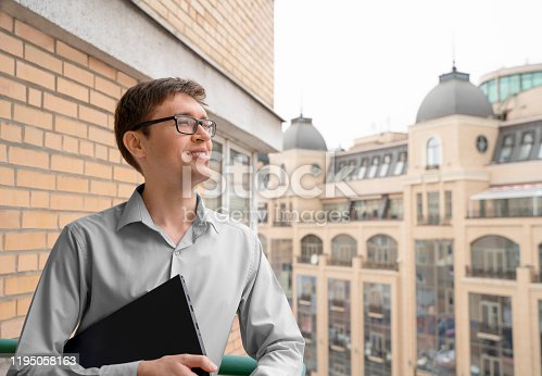 istock Inspired student, future civil engineer, while practical activity of new buildings construction in the city. Young man looking optimistic and happy. 1195058163
