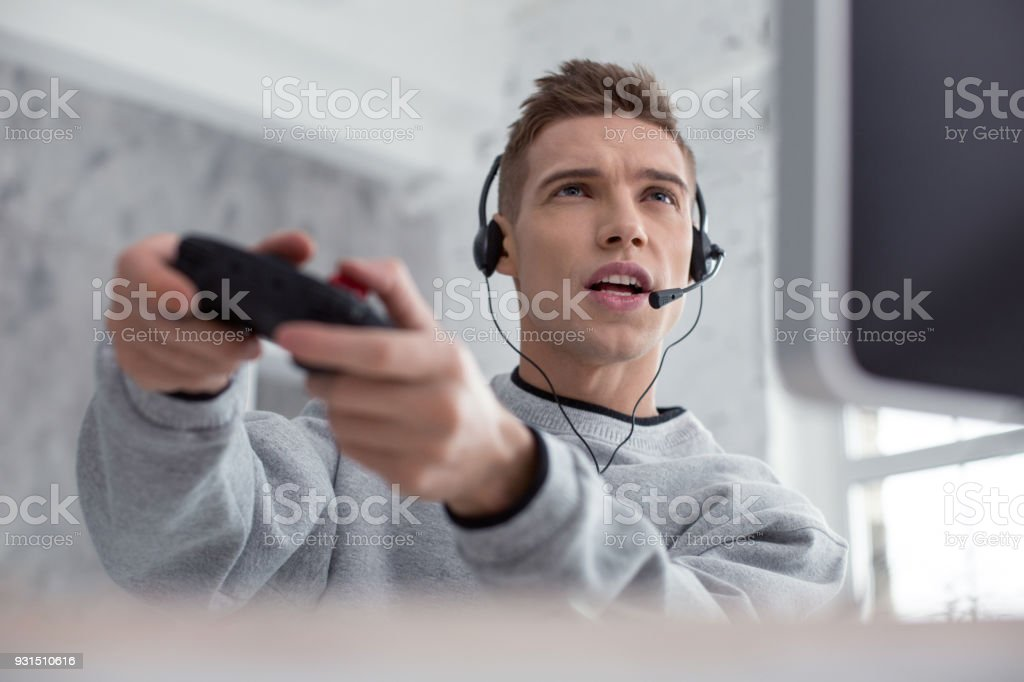 Inspired teenager playing a computer game stock photo