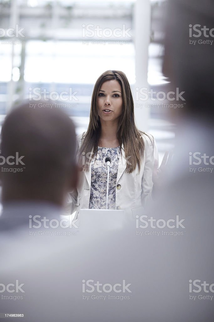 Inspiring her colleagues royalty-free stock photo