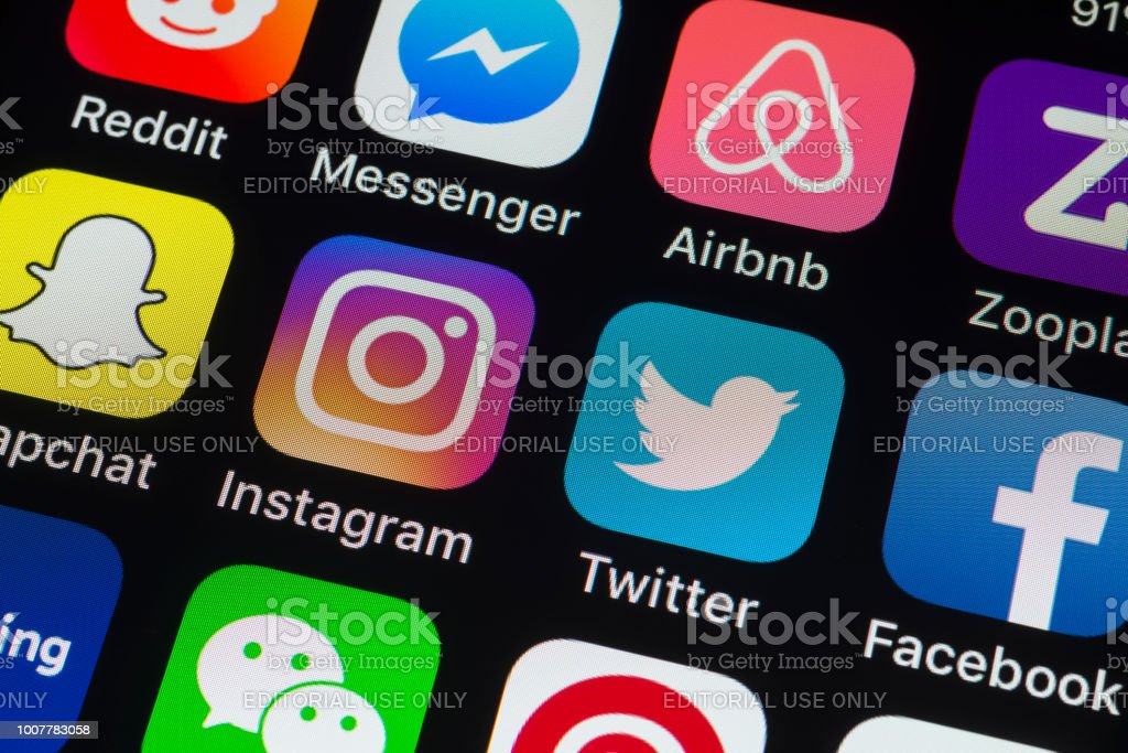 Instagram, Facebook, Twitter and other phone Apps on iPhone screen stock photo