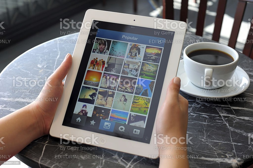 Instagram on iPad 3 royalty-free stock photo