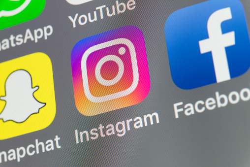 Instagram, Snapchat, Facebook and other cellphone Apps on iPhone screen