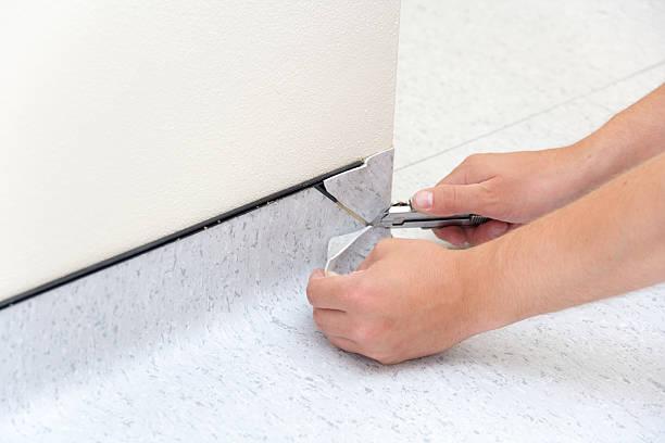 Instaling PVC Floor Installing new tarkett floor linoleum stock pictures, royalty-free photos & images