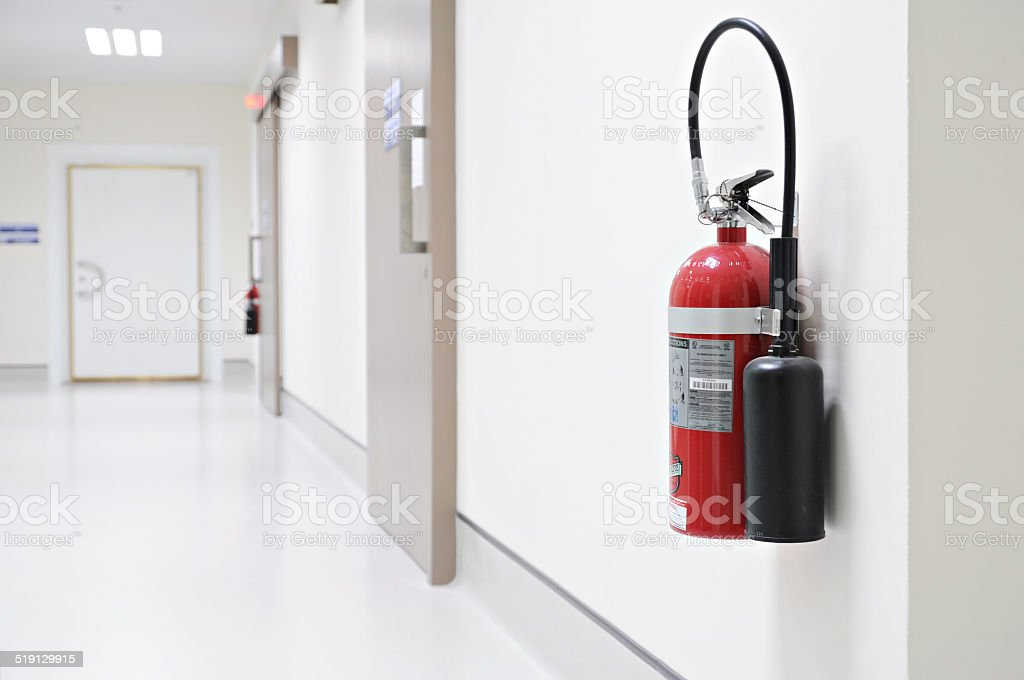 Install a fire extinguisher on the wall in hospital stock photo