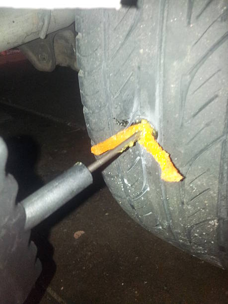 Install a tire plug patch stock photo