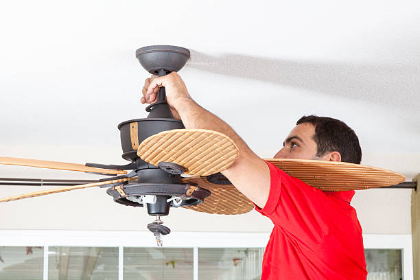 Install Ceiling Fan Men installing ceiling fan. ceiling fan stock pictures, royalty-free photos & images