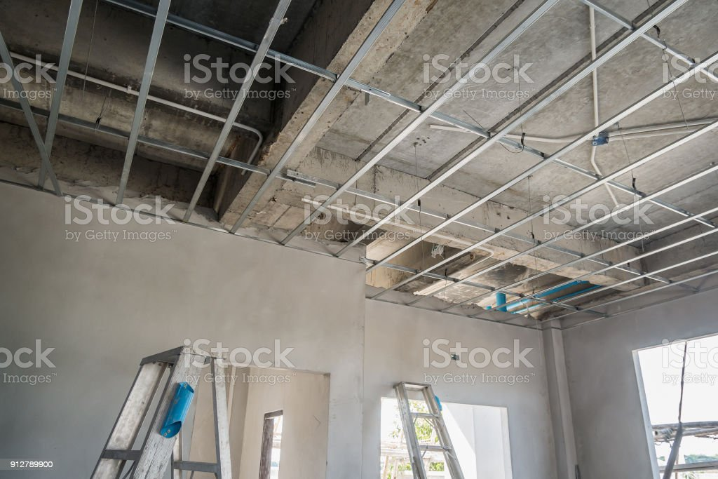 Install Metal Frame For Plaster Board Ceiling At House Under Construction Stock Photo Download Image Now