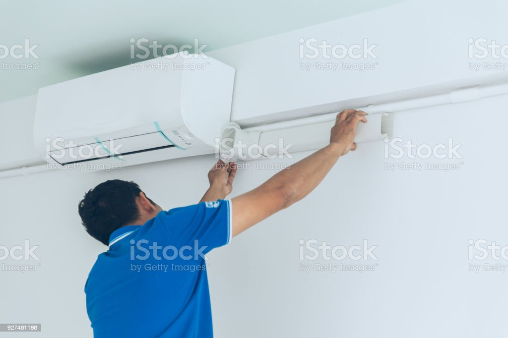 install new air conditioner in hot summer season by professional stock photo