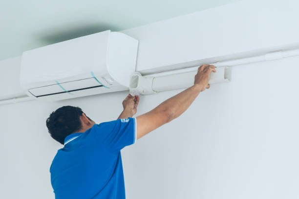 install new air conditioner in hot summer season by professional install new air conditioner in hot summer season by professional household fixture stock pictures, royalty-free photos & images