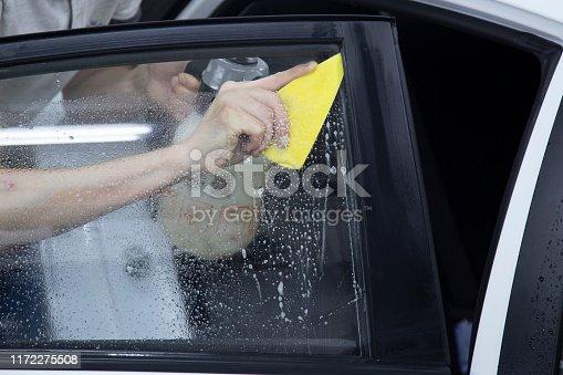 1145626150 istock photo Install windows film on the car. 1172275508