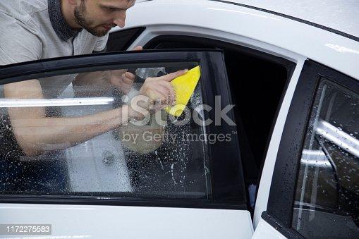 1145626150 istock photo Install windows film on the car. 1172275583