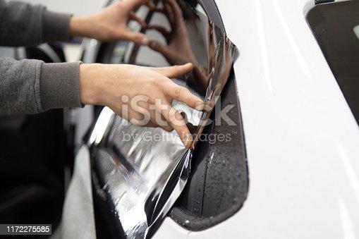 1145626150 istock photo Install windows film on the car. 1172275585