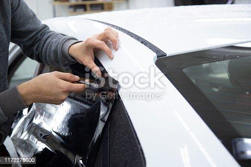 1145626150 istock photo Install windows film on the car. 1172275600